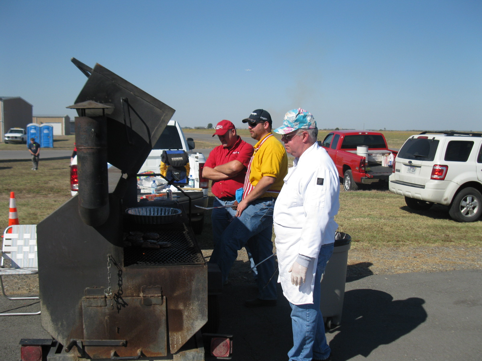 Carlisle Lions grill hamburgers and hot dogs for a hungry crowd at the second annual Carlisle Airport Day.