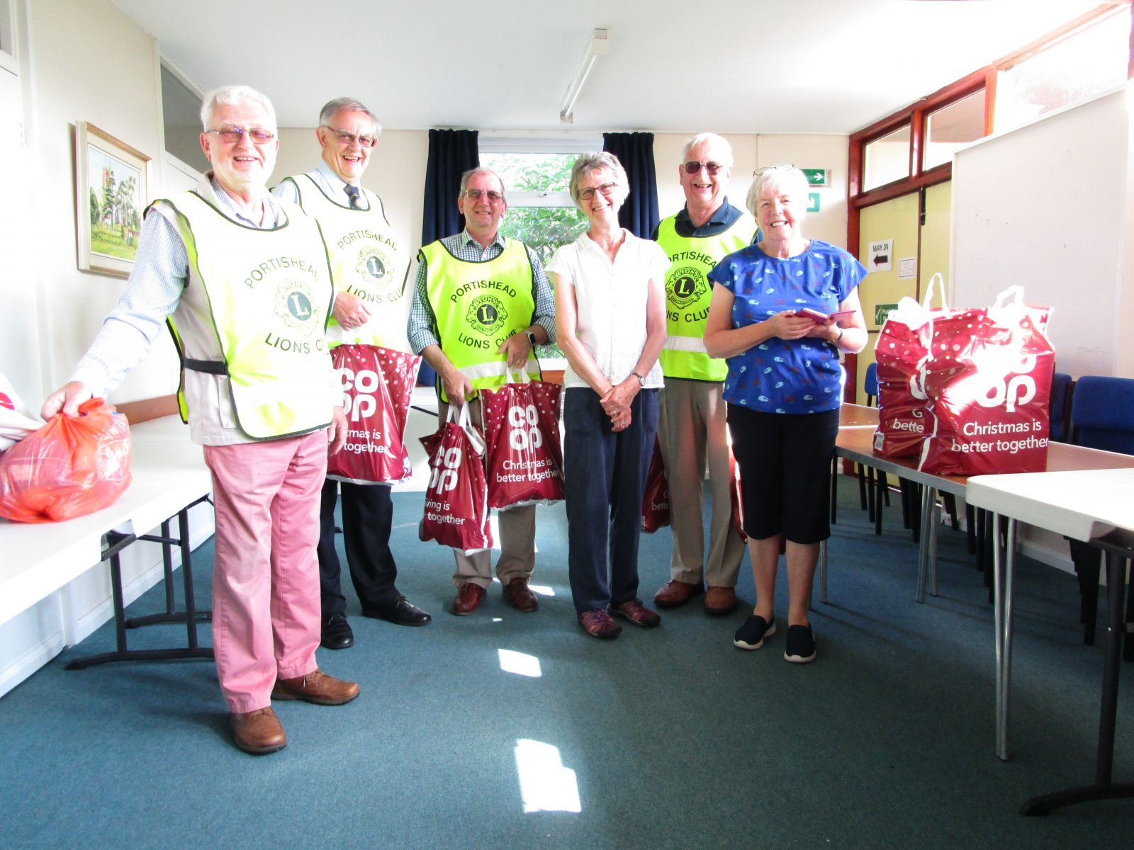 In this photo Lions members collecting the hampers from Elspeth Davis and Pom Langton at St Georges Hall,  Pill