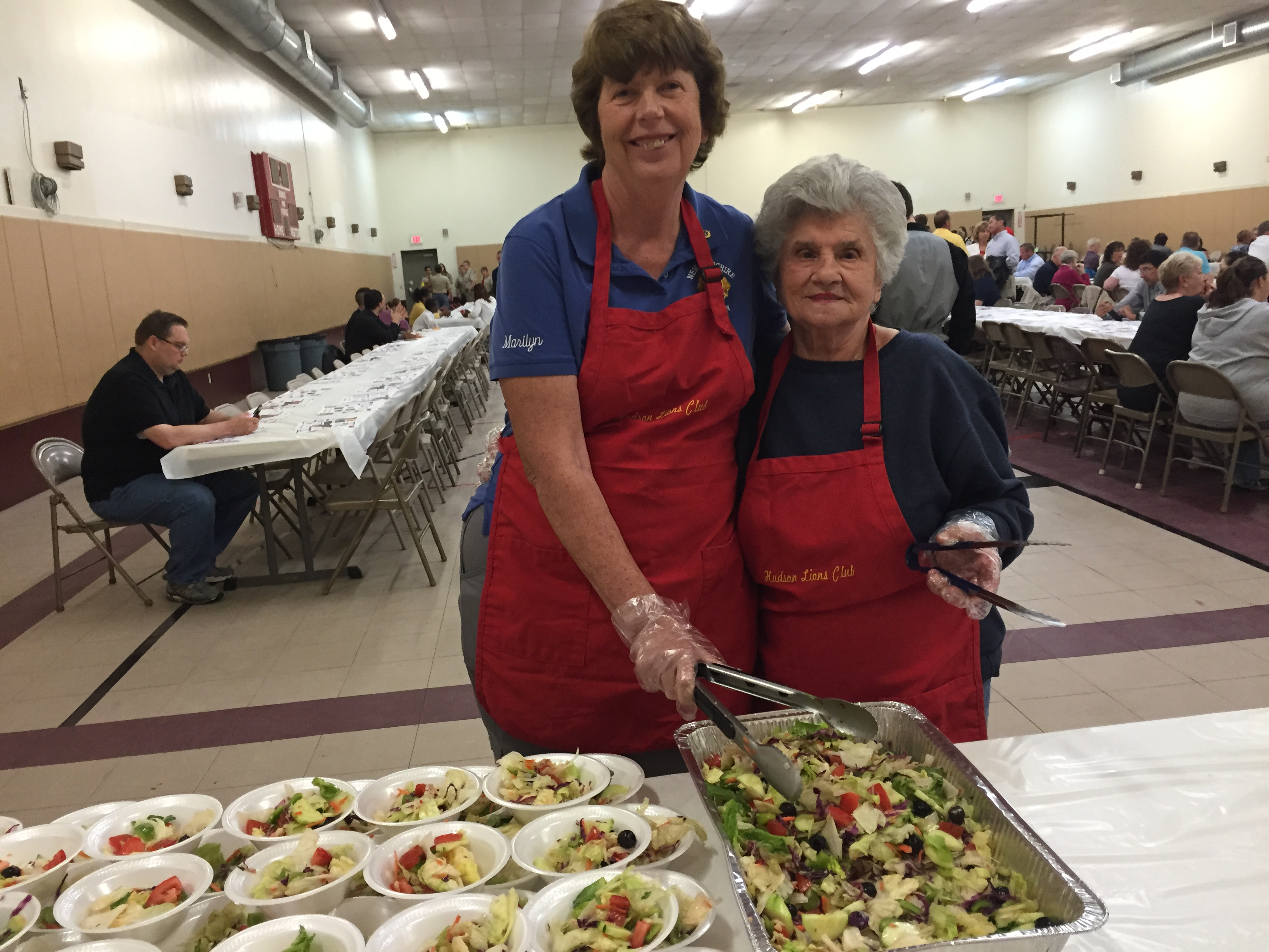 Marilyn Richardson and Maria Vaccaro serving salad.
