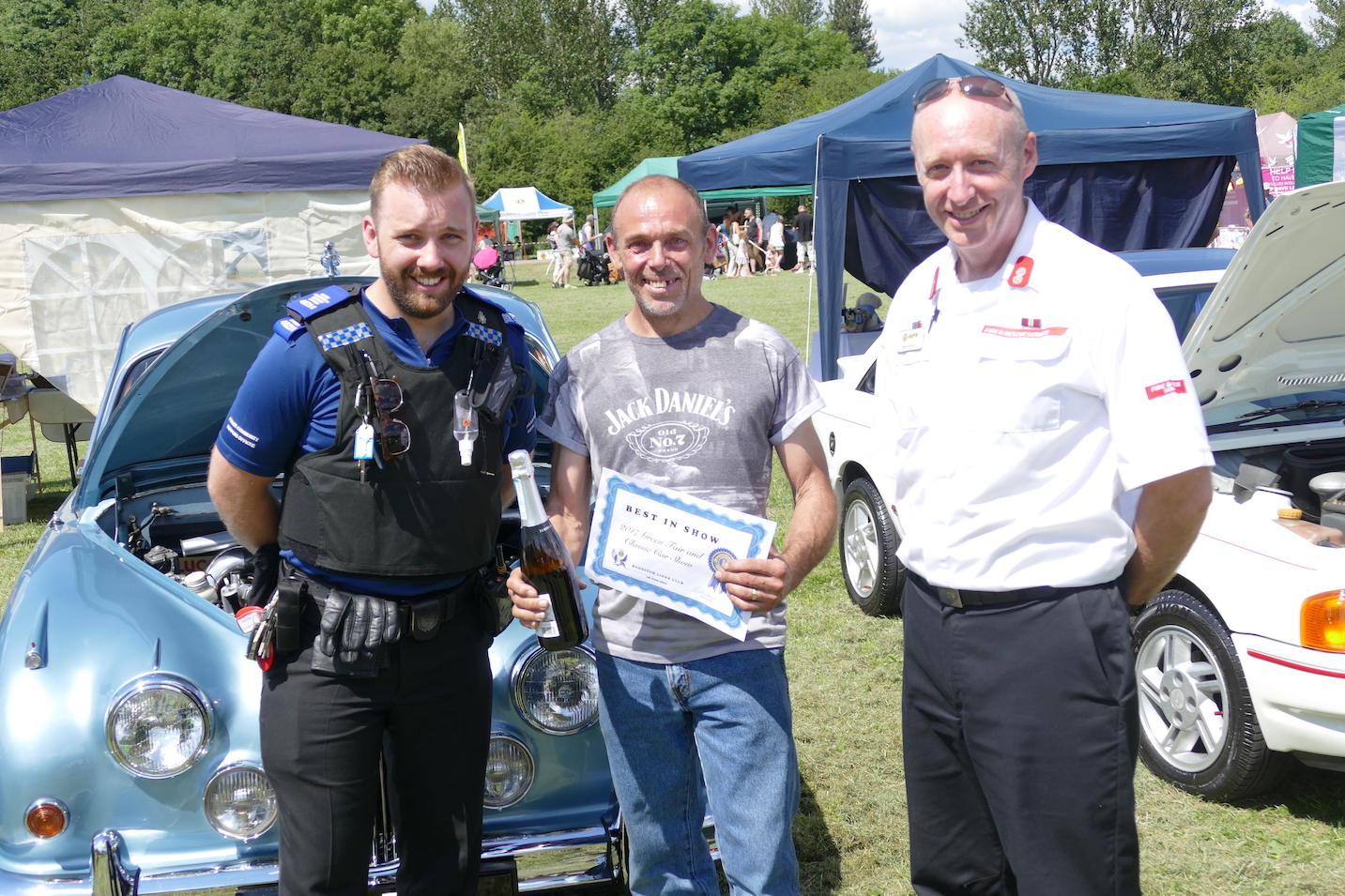 Judges from the Fire and Police Services award BEST IN SHOW to JAGUAR MKll owner