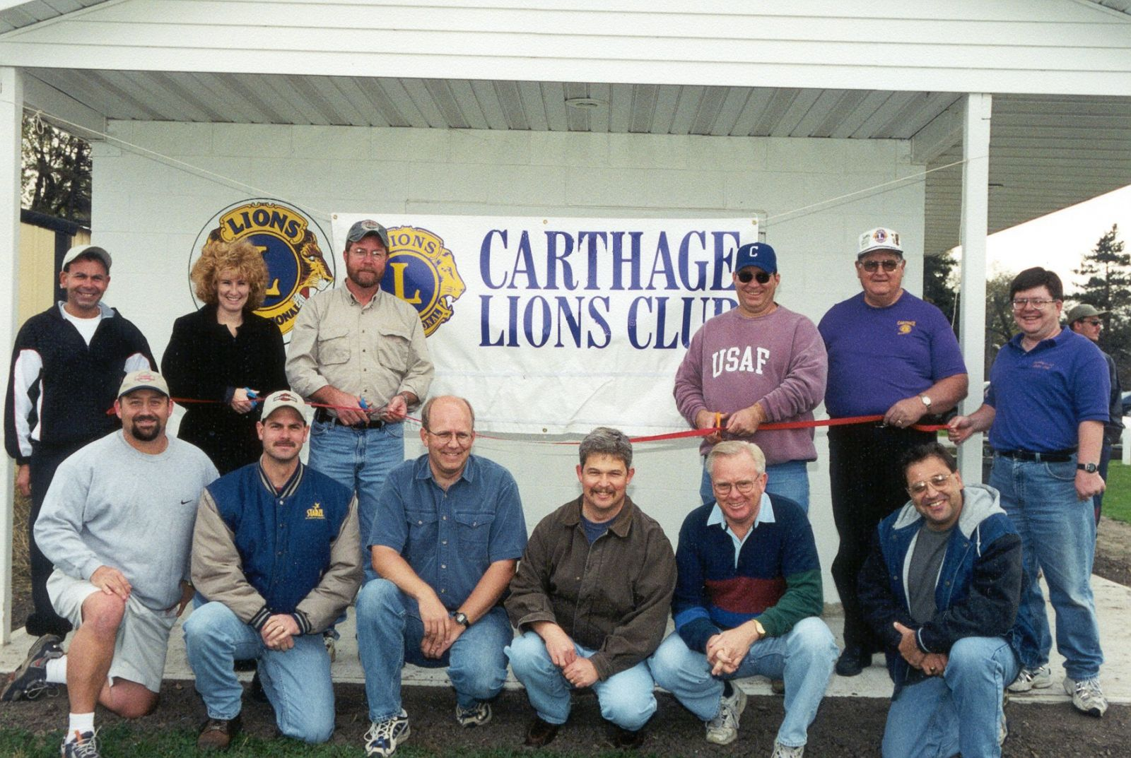 Members of the Lions Club at a Ribbon-Cutting ceremony for the new concession stand at the ballpark that we built.