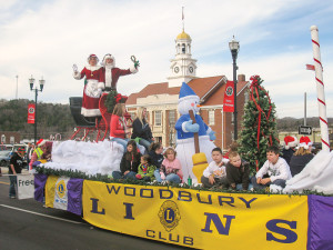 Santa and Mrs. Claus greet folks from the Lions Club parade float!