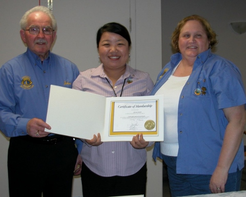 Shiny Xiao at her initiation with Membership Chair John Wilson and Betty Ann Adams (right).