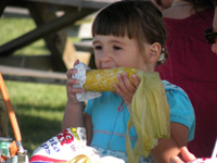 Young girl eating corn on the cob