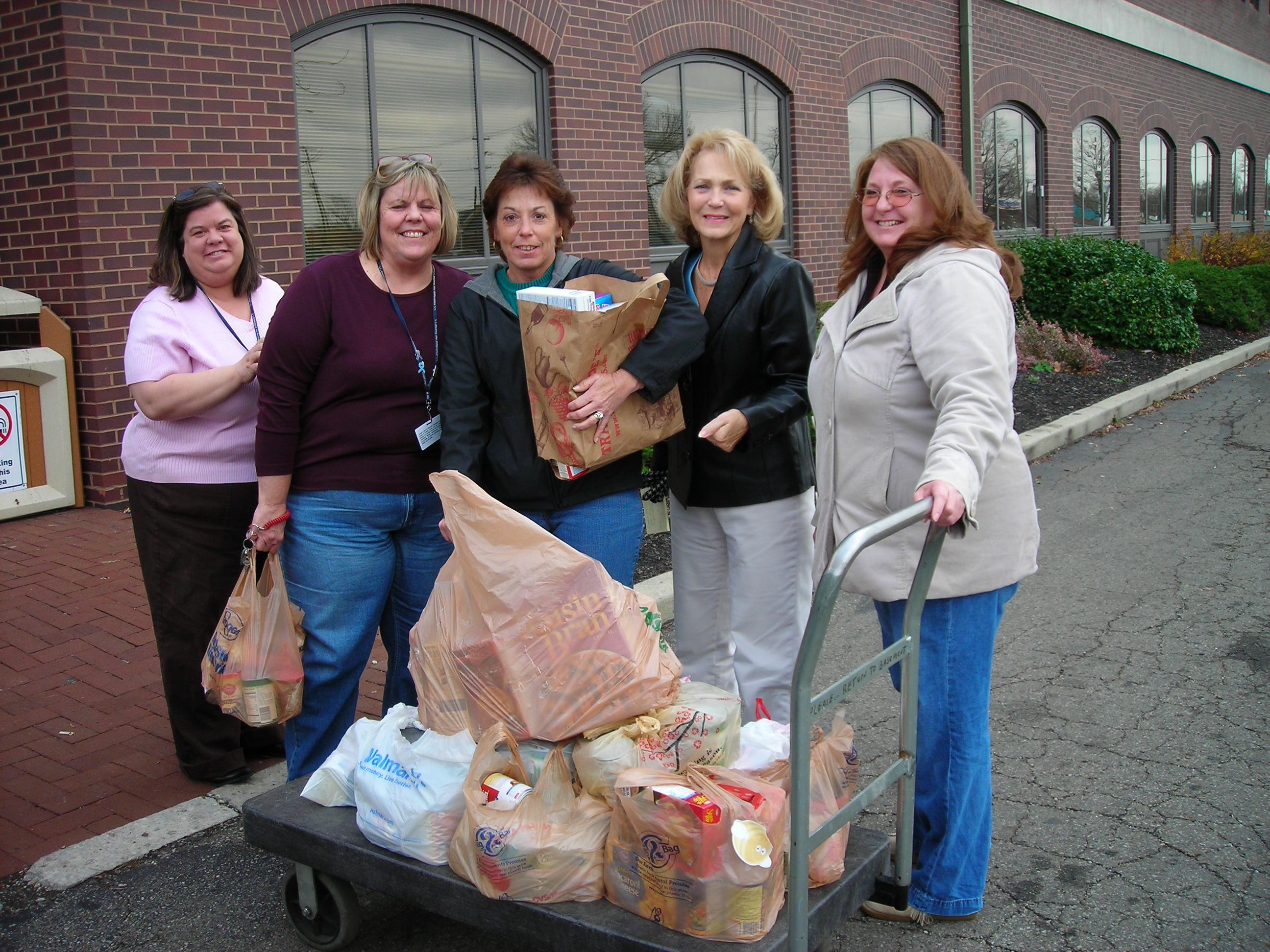 Lion Connie McClellan delivers a portion of the club's food donations to Family Services