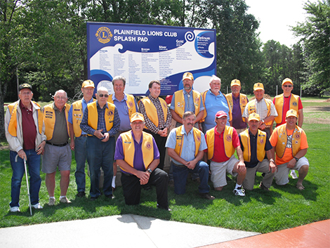 Lions club members dedicate splash pad.