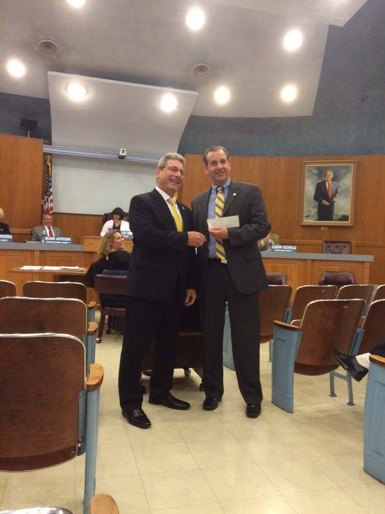 Wayne Lions President Paul Ciavarella presenting $1,500 check to Paul Margiotta, Wayne Township Clerk on behalf of Wayne Volunteer First Aid Squad