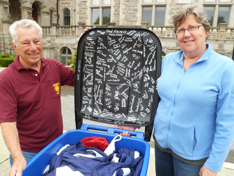 Lions John Medeiros and Diane Brodeur with Flag and container signed by Fairhaven High School Class of 2014 who donated new flag.