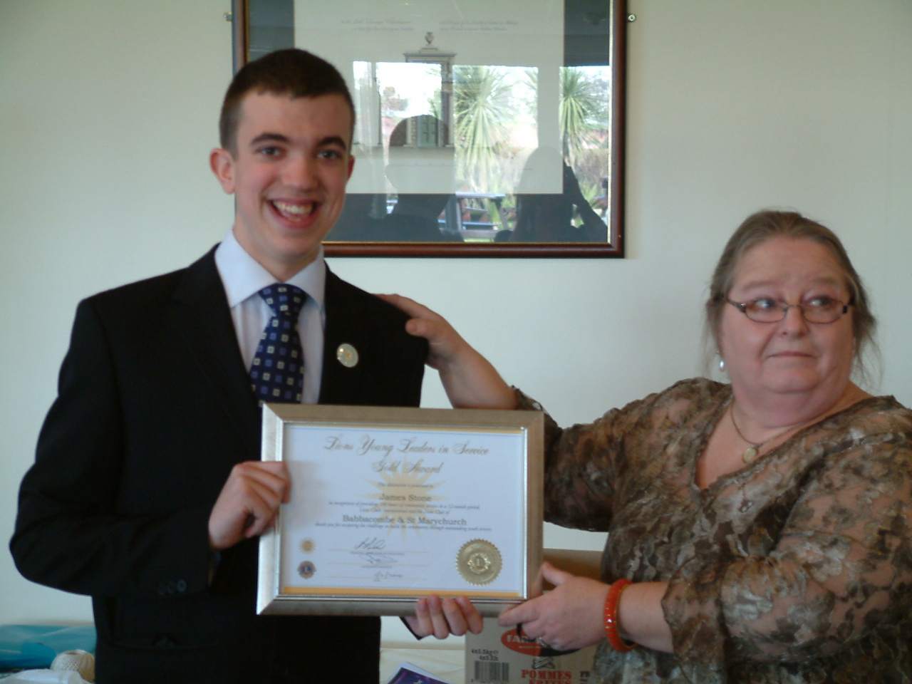 James receives his Badge & Gold Certificate from Lion Leslie Chudley