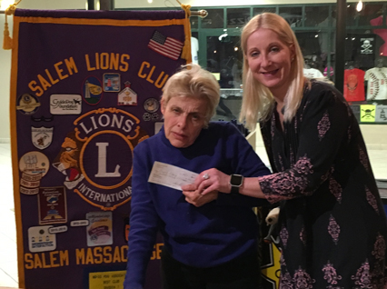 Christie Parker presenting check for $570 to Meredith McDonald director of Salem Council on Aging at our Feb 6th meeting.