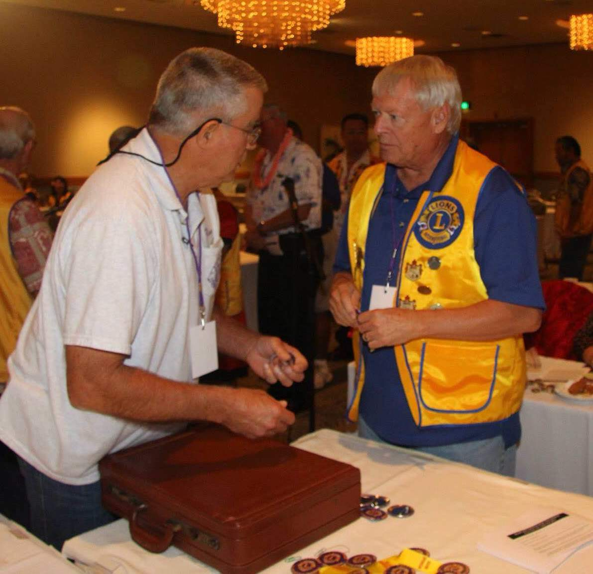 Prexy Jim receives a platinum ribbon for the club after EKLC's donation at the Parade of Checks. Several individual EKLC Lions including Prexy Jim and Secretary Shirl, Elaine and Steve Saiki, and Janice Bond also made donations to the Hawaii Lions Foundation