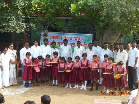 Lion Club members distributing School Kits to the students