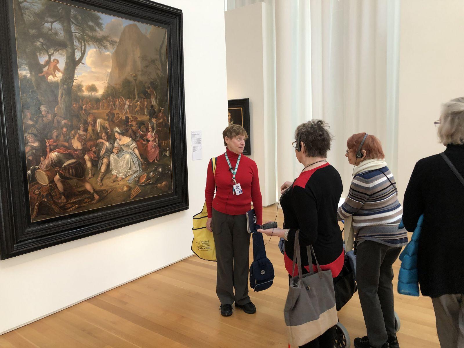 Elizabeth Kahn, NC Museum of Art Volunteer Docent Tour Guide, explaining  painting