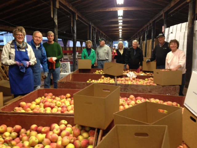 The club gathering to pack apples