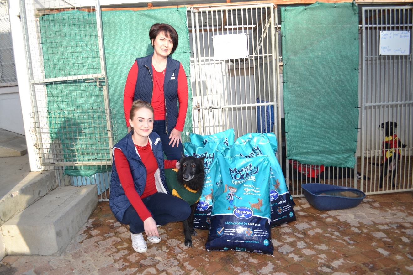 Members of Gordon's Bay Lions Club deliver a donation to the Animal Welfare