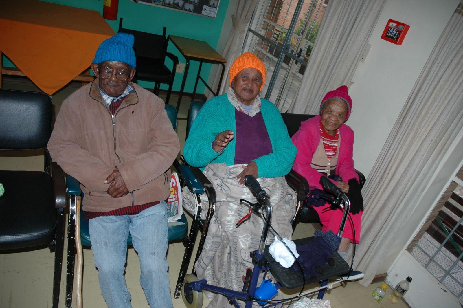 Huis Silverjaare residents enjoying the beanies knitted by Gordons Bay Lions Club Members
