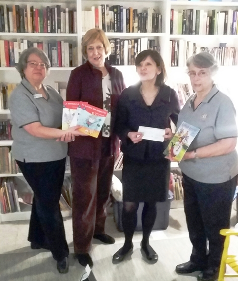 Lion Roberta Landerman and Lion Carol Rodger with President Johanne Aucoin and Director General Nicole Lemire at the inauguration of the new library at Maison de la Famille