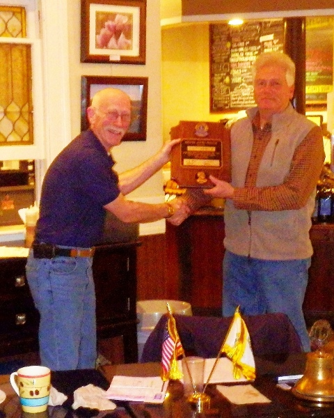 Stafford Lions Club president Rick Dewey presents Melvin Jones Fellowship plaque to Lion Bob Campbell