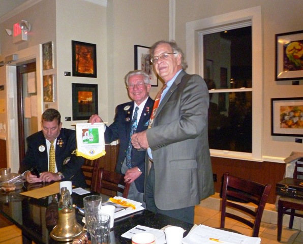 President Bob Bourque presents Stafford Lions Club banner to District Governor, Steve Novic