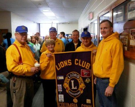 Lions around banner