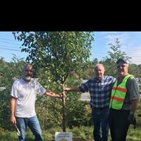 Planting a tree on the new Salem Rail Trail as part of our environmental legacy project