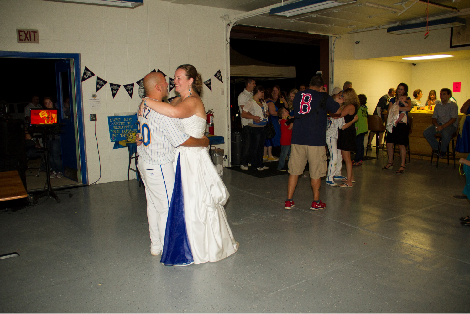 Bride & groom having their first dance at a wedding at the clubhouse