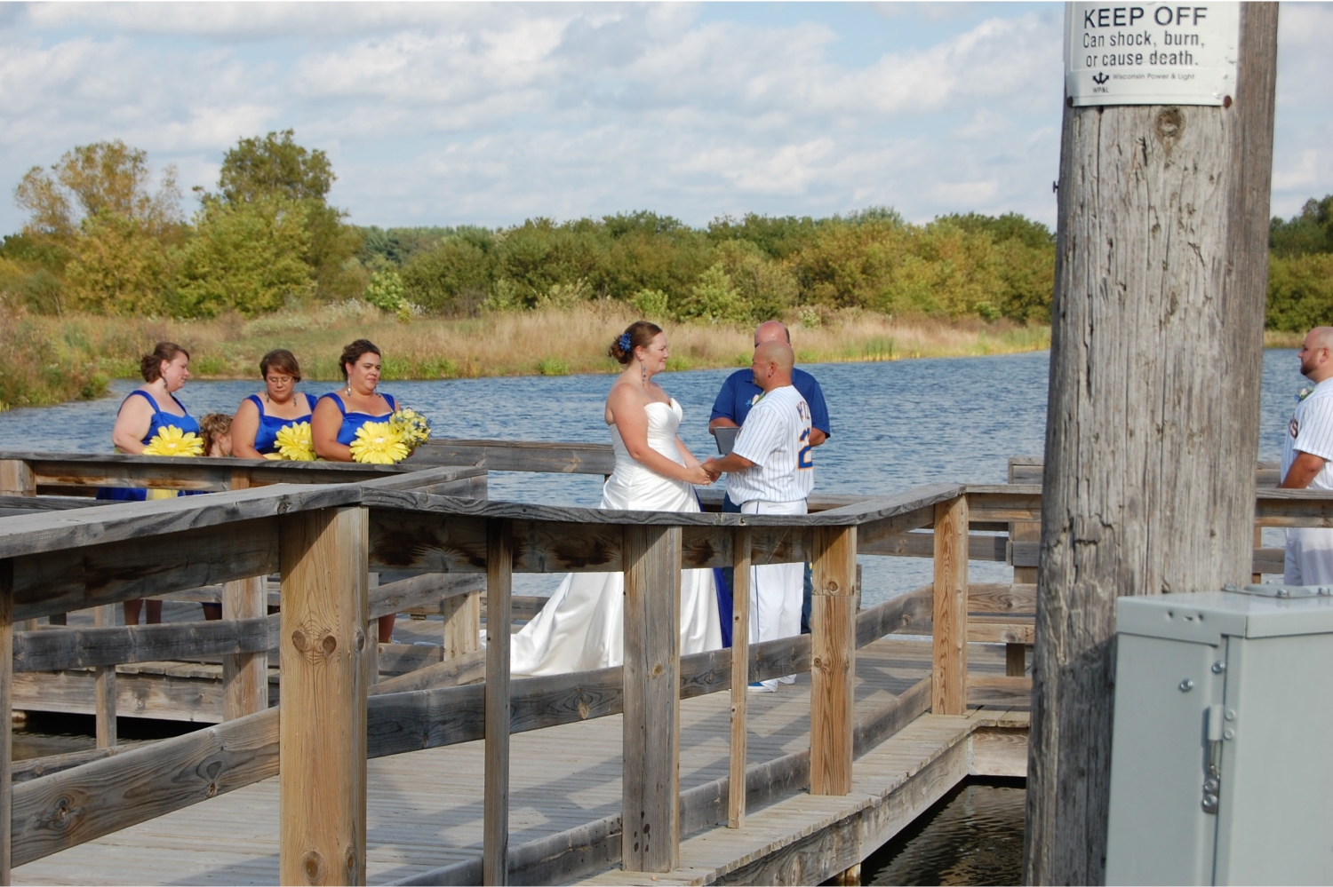 Wedding ceremony on the dock at the Lions clubhouse