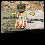 3 Set of Old Timer hunting & fishing knives & sharpener, two XL Mountain Man Guns T-shirts and a baseball cap.  Value $80