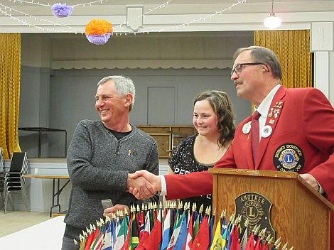 Lion Howard receives award for long service from D.G. Lion Dan Babyak, at D.G. Night.  Also shown is President Lion Jolene.