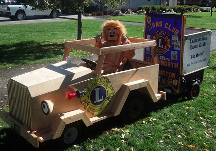Lion Duane driving cart in parade