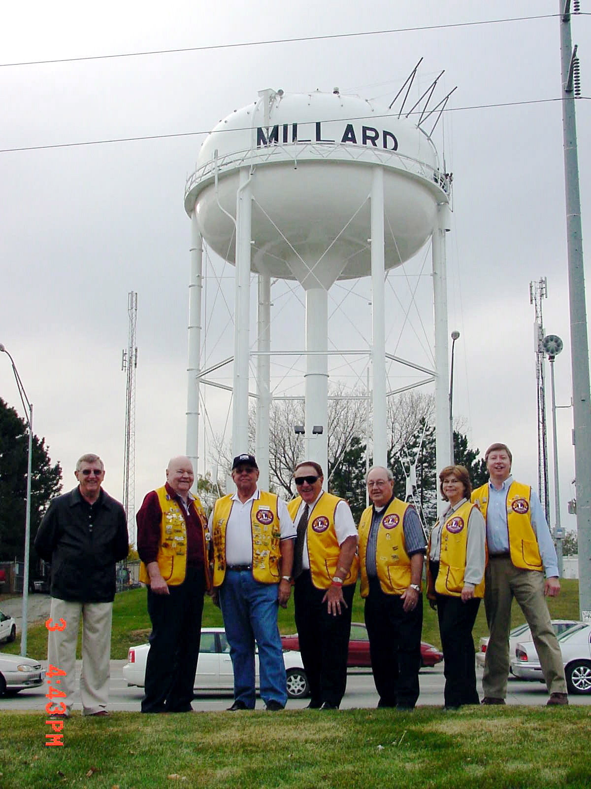 Photos from Millard Lions Club history.  Pictured here is the big reveal of returning MILLARD to the water tower in 2005.  The Millard Lions Club provide the lead gift to the Millard Business Association to get the ball rolling.