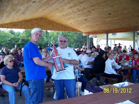 Ken Perry receiving his best of show trophy for his Mustang convertible.