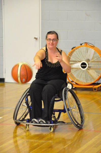 Trying out wheelchair basket ball - not as easy as the experts make it look!