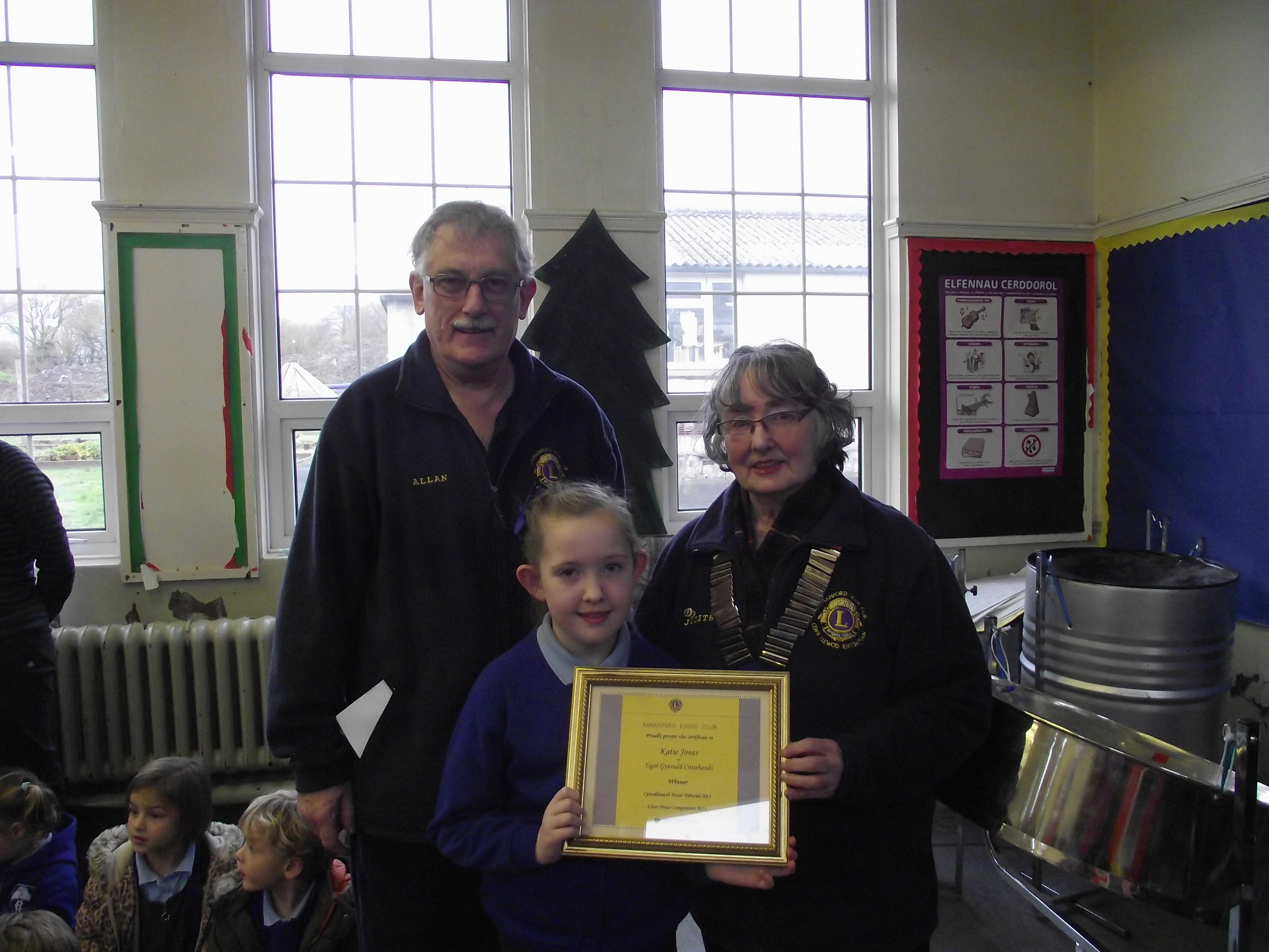 Presenting cheque and certificate to winner at Crosshands Primary School