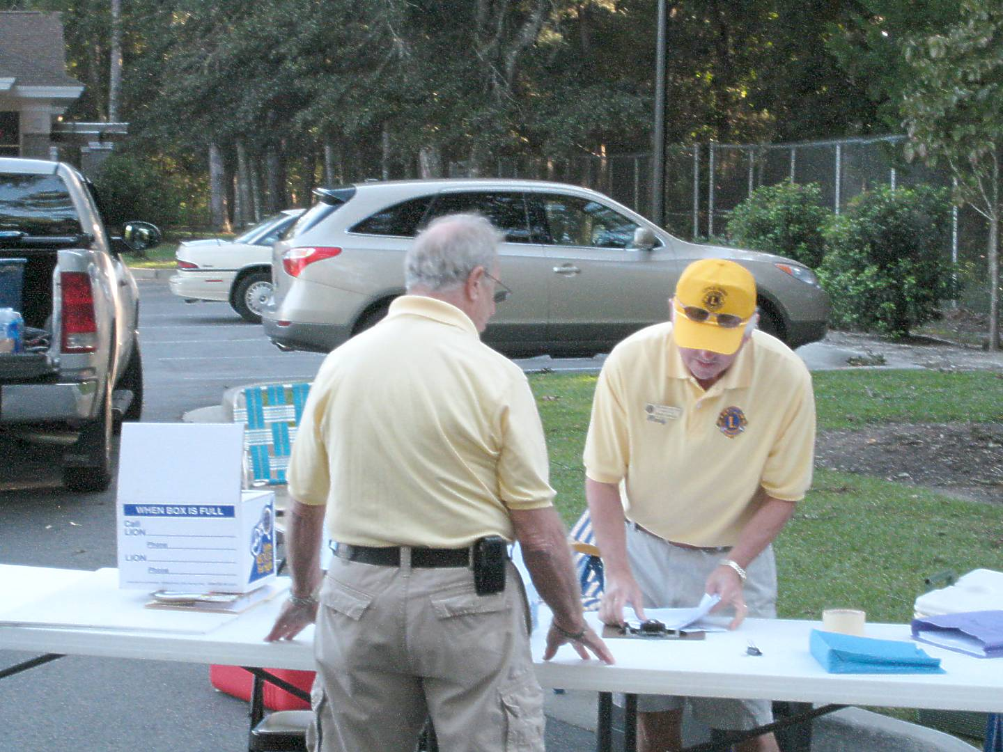 Lions Nick Lopano and Randy Edwards organize the welcome desk.