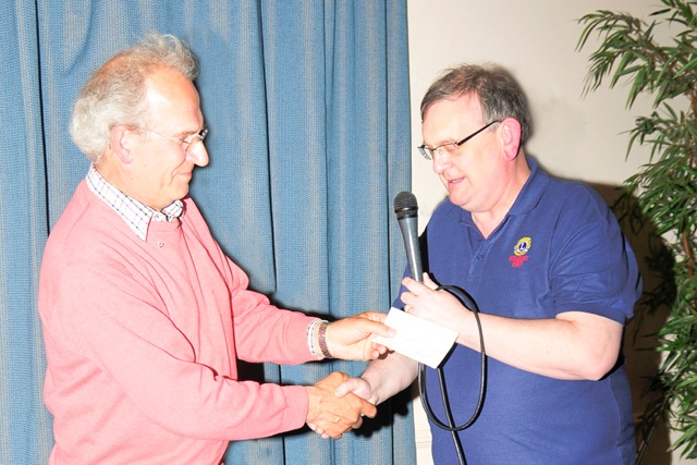 Ballynahinch Lions Club present a cheque for £250 for Club funds