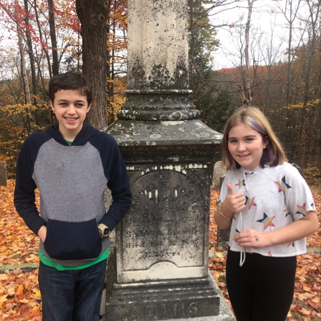 Finding the right gravestone during the scavenger hunt.