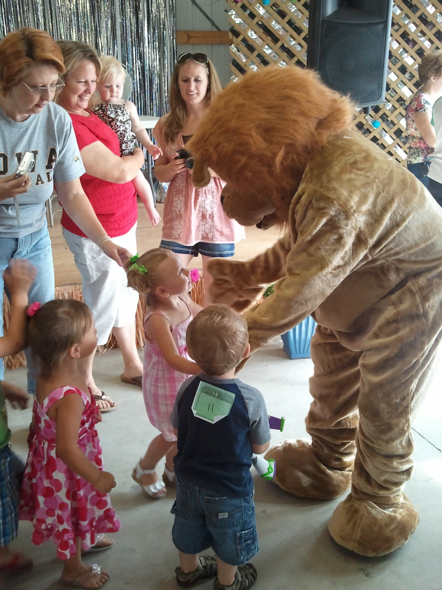 Oskaloosa Lions mascot Dan DeLion greets children at the Southern Iowa Fair
