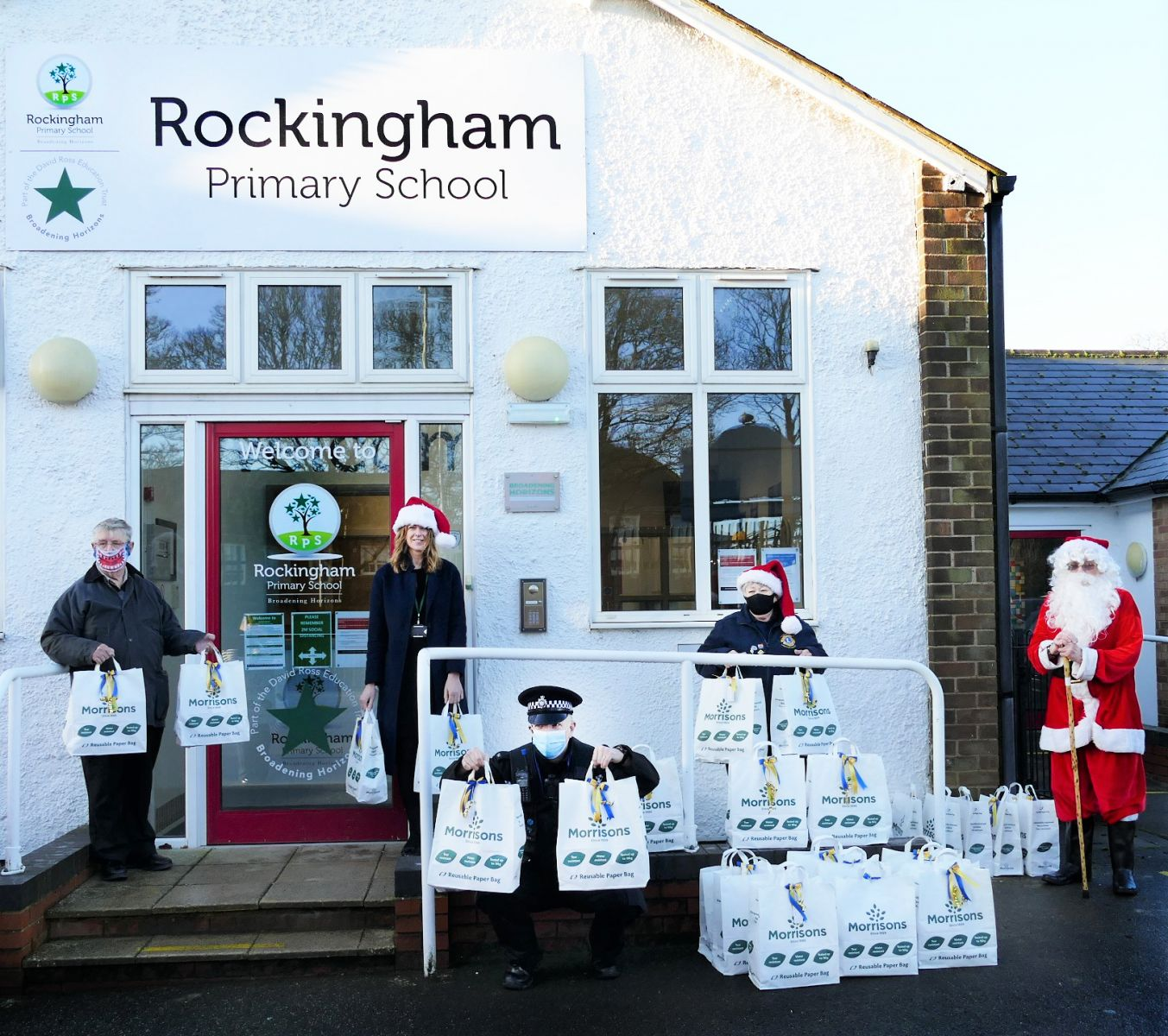 Corby & District Lions Club were contacted by PC Chris Vickers who through Tracey Hudson, head teacher at Rockingham Primary School highlighted the need for christmas treats for families, many who would have gone without. Corby Lions contacted Morrisons where Tricia Robins, the Community Champion assisted with purchasing and packing over 40 bags of Christmas treats. Working together with Corby community, Corby Lions members along with Santa Claus (Ronnie Vickers), Jenny Clarke, Dan Macdonald were able to spread goodwill at this difficult time. Corby lions would like to wish all a Very Merry Christmas and a Safe and Healthy 2021.