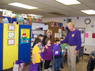 Harry distributing books at Montcalm Elementary.