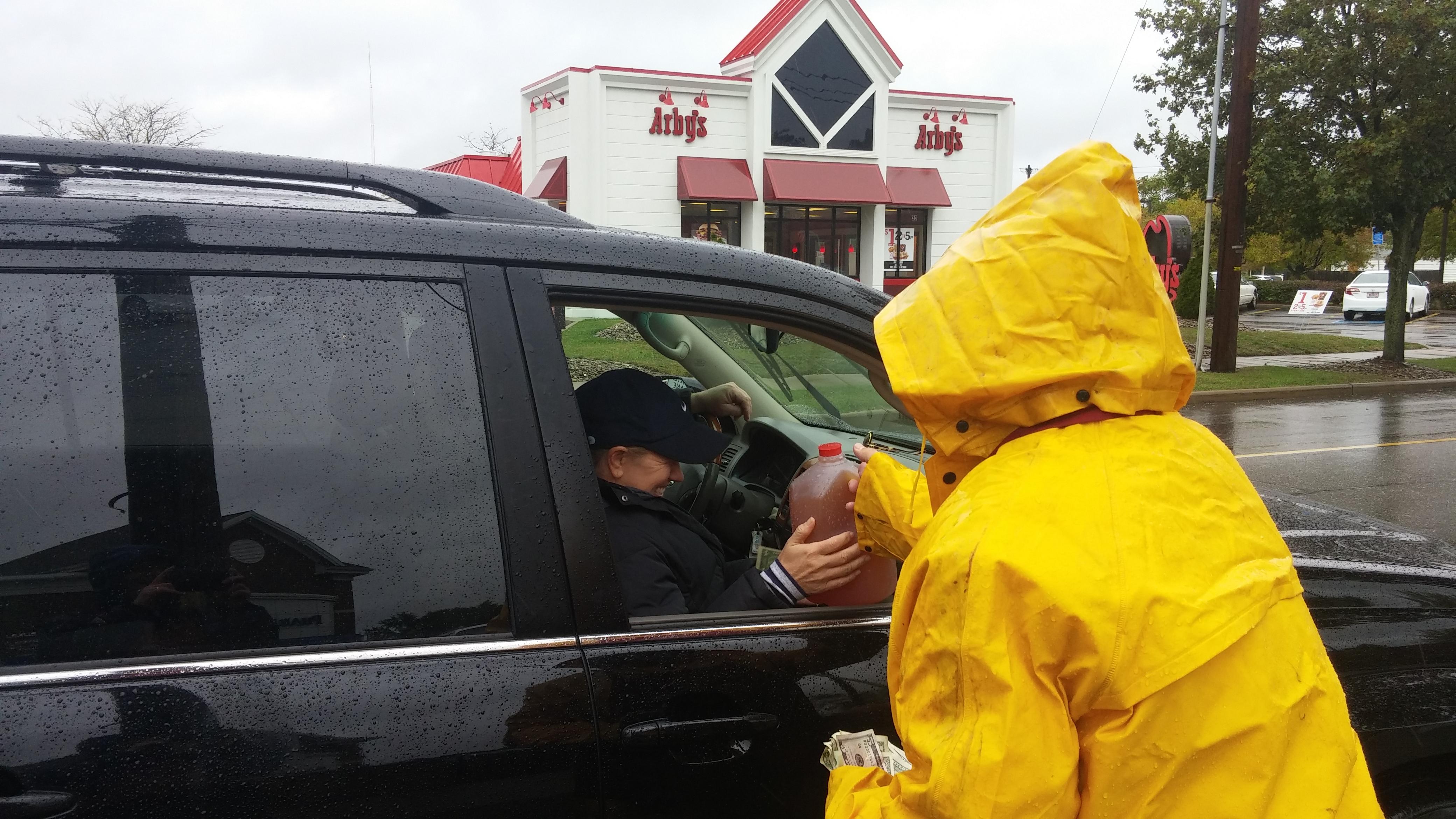 Lion Mayor Dave Kline selling cider
